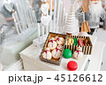 Variety of sweet macaroons in carton box. Cookie in the form of a snowman. Merry Christmas card. New 45126612