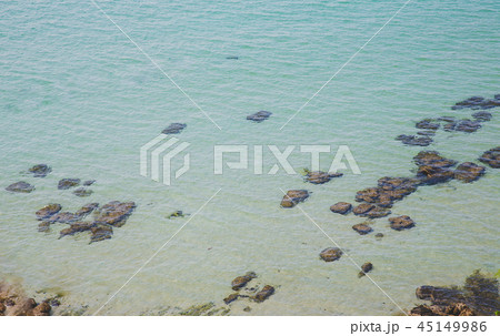 Aerial view to clear blue green sea with rocks 45149986