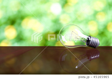 Light bulb on wooden table 45165965