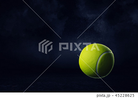 3d rendering of a yellow tennis ball on a dark background. 45228625