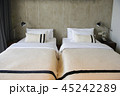 Modern hotel room with twin beds and copy space 45242289