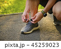 Man tying jogging sport shoes 45259023