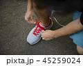 Man tying jogging shoes 45259024