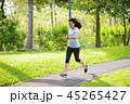 Young asian woman jogging in a park looking to sma 45265427