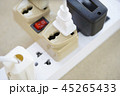 Electrical power strip overloaded with many plugs 45265433