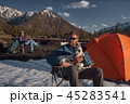 Couple with his dalmatian dog at camping outdoors mountain terrain 45283541