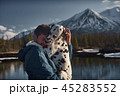 Man playing with his dog outdoors mountain terrain 45283552