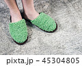 feet in soft Slippers on the carpet   45304805