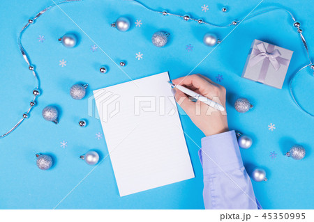 Holiday decoration and notebook on blue background 45350995