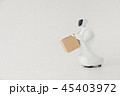 Humanoid autonomous robot with cardboard box in hand on white background. the robot delivers the 45403972