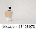 Humanoid autonomous robot with cardboard box in hand on white background. the robot delivers the 45403973