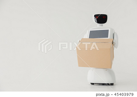 Humanoid autonomous robot with cardboard box in hand on white background. the robot delivers the 45403979