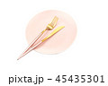 Pink plate and cutlery isolated 45435301