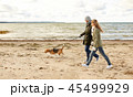 happy couple with beagle dog on autumn beach 45499929