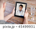 patient having video chat with doctor on tablet pc 45499931