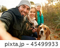 happy family with dog taking selfie in autumn 45499933