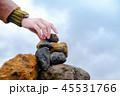 Faith and Spiritual Concept. Woman dropping a rock 45531766
