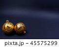 Golden Christmas baubles on black background. 45575299