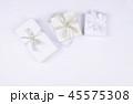 Three gift boxes on white background. 45575308