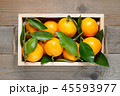 Mandarins in wooden box top view 45593977