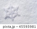 Snowflake christmas decoration on snow top view 45593981
