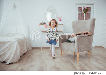 Happy girl playing in a bright room 45604772