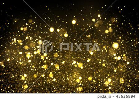 Sparkling golden particles explode 45626994