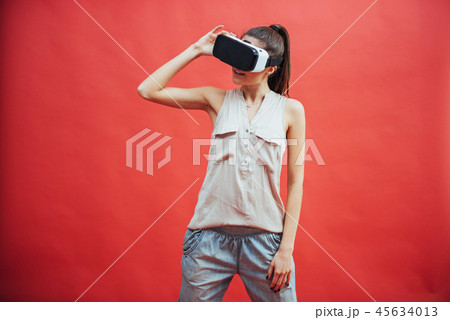 portrait of happy smiling young beautiful girl, gain experience using VR-headset virtual reality 45634013
