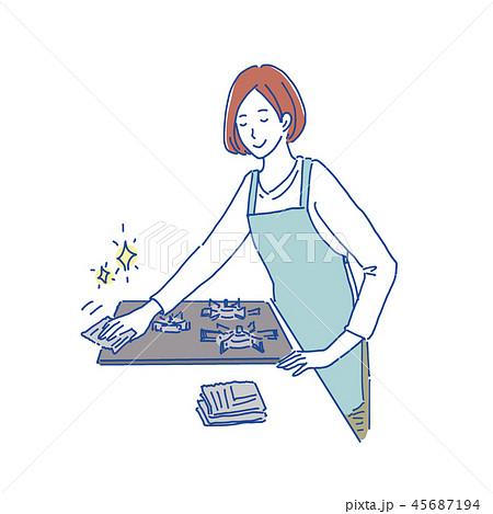 コンロを新聞紙で掃除する女性 イラスト 45687194