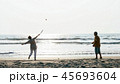 Active senior couple playing tai chi ballon ball at the beach. 45693604