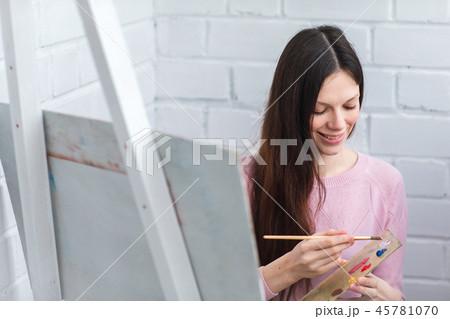 Beautiful woman draws 45781070