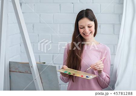 Beautiful woman draws 45781288