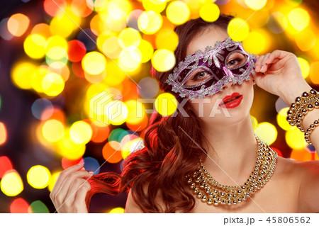 Beauty model woman wearing venetian masquerade carnival mask at party 45806562