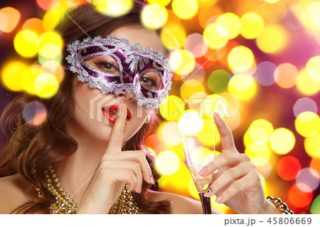 Beauty model woman wearing venetian masquerade carnival mask at party 45806669
