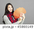 woman showing red envelopes for chinese new year 45860149