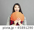 woman showing red envelopes for chinese new year 45891290