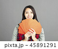 woman showing red envelopes for chinese new year 45891291