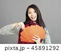 woman showing red envelopes for chinese new year 45891292