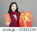 woman showing red envelopes and gift  45891294