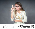 Portrait of woman with attention gesture. She 45909015