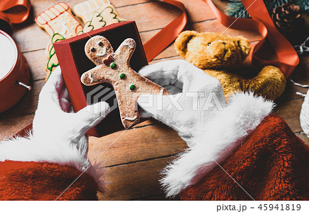 Santa Claus have wrapping a Christmas cookie 45941819