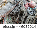 Old fishing nets with red float lay in port 46082014