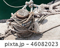 Old rusted mooring bollard with naval ropes 46082023