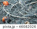 Fishing nets with red floats lay in port. Close-up 46082026