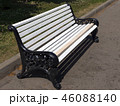 White wooden bench in the park on the street. 46088140