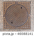 Old rusty sewer hatch on an old metal plate.  46088141