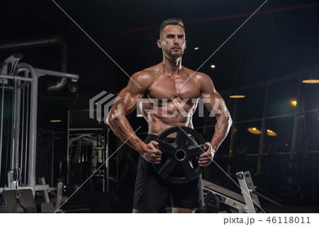 Man muscular athlete stand confidently. Attractiveの写真素材 [67178815] - PIXTA