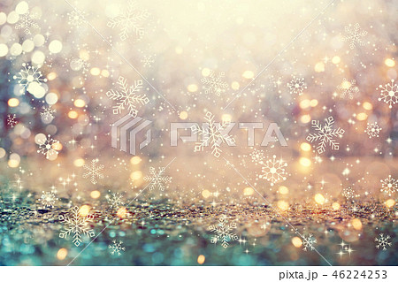 Snowflakes on an abstract shiny light background 46224253