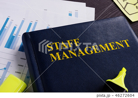 Staff management book and documents on a desk. 46272604
