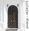 Old wooden door with metal wire 46291375
